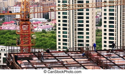 Construction workers at work - High angle view of...