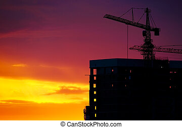 Industrial construction crane silhouettes