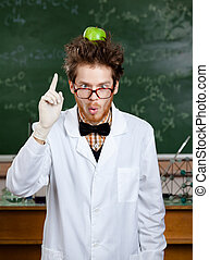 Crazy scientist with an apple on his head shows forefinger