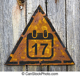 Calendar with Date Icon on Rusty Warning Sign.