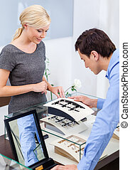 Man selecting engagement ring at jeweler's shop. Concept of...