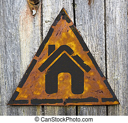 Home Icon on Rusty Warning Sign - Home Icon on Weathered...