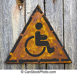 Disabled Icon on Rusty Warning Sign - Disabled Icon on...
