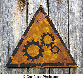Cogwheel Gear Icon on Rusty Warning Sign. - Cogwheel Gear...
