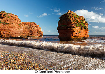 Ladram Bay Devon England UK - Dramtic red Jurassic cliffs at...