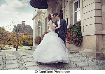 Young wedding couple dancing outdoor - Young cute wedding...