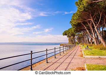 Promenade and pine trees in Bolsena lake, Italy - Promenade...