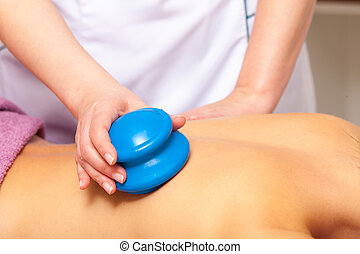 Beauty salon. Woman getting spa cupping glass vacuum massage...