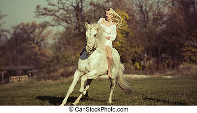 White angel riding a pure white horse - White female angel...