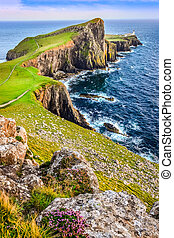 Vertical view of Neist Point lighthouse and rocky ocean coastline, Scotland, United Kingdom