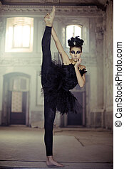 Fit young ballet dancer as a swan - Fit young ballet dancer...