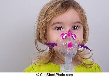 Kid using Nebulizer with Caution - Nine years old kid with...