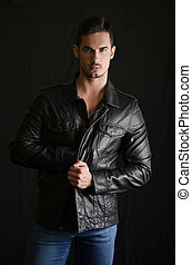 Portrait of attractive young man with leather jacket and...