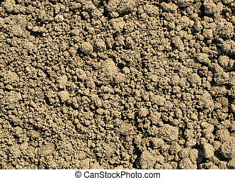 Freshly dug garden soil close up natural background