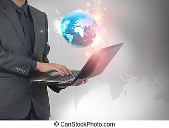 businessman holding world