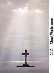 Stone Cross - A Cross made of stone erect on an island off...