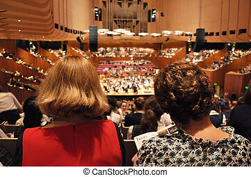 Audiences in concert hall - Spectators watching symphony...