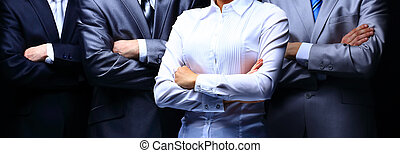 Group portrait of a professional business team on dark background