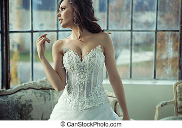 Brunette bride resting after wedding reception - Brunette...