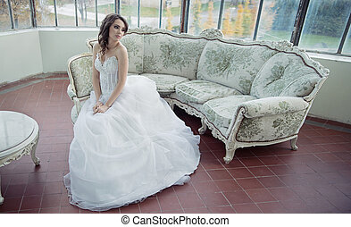 Stressed bride wearing beautiful wedding gown - Stressed...