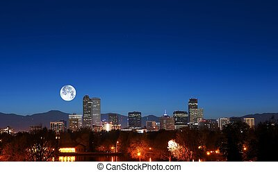 Denver Skyline with Moon. Downtown Denver and Rocky...