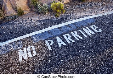 No Parking Sign on Pavement with Inverted G Letter by...