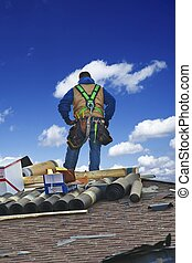Roofing Works - Roofing Contractor on the Roof Repairing...