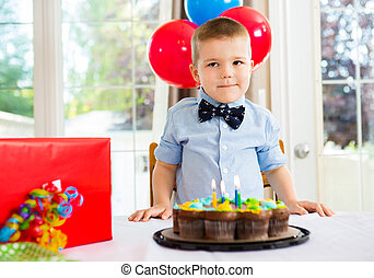 Birthday Boy With Cake And Present On Table