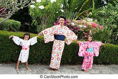 Family dressed in kimono - Family portrait of a beautiful...