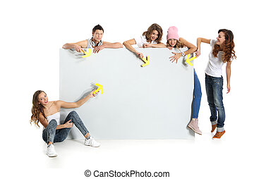 Group of young people holding an em - A team of young...
