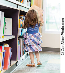 Girl Selecting Book In Library