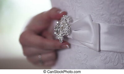 Belt of wedding dress - Beautiful bride adjusts his belt...