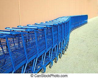 Line of Shopping Carts - Shopping Carts lined up outside a...