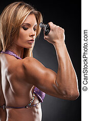 Close up of muscular female hand Brawny beautiful blond...