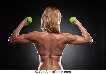 Back of beautiful sexy bodybuilder woman with green...