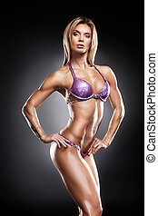 Beautiful female bodybuilder showing her sexy body Posing on...