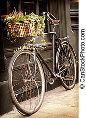Vintage bicycle - Old bike with flowers in the shopping...
