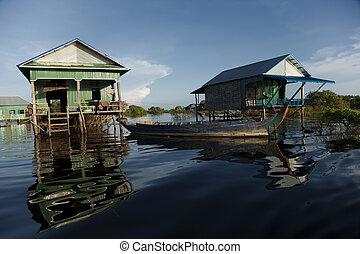 Wooden stilt houses in Kampong Phluk village in Siem Reap...