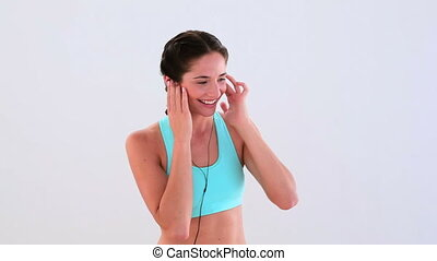 Fit brunette listening to music