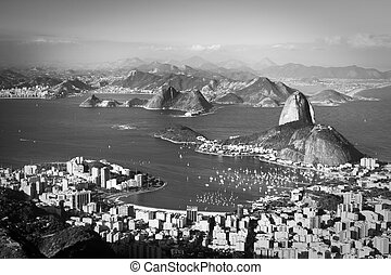 Sugar Loaf in Rio de Janeiro - The sugar Loaf is a green,...