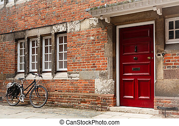 English street - Retro bicycle leaning against the wall of...