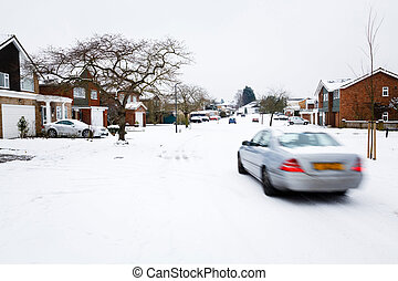 Winter driving - Car driving in winter snow on a road in...