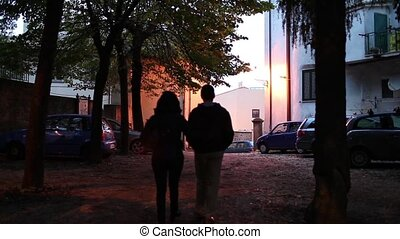 Couple Walking In The Evening