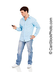 man using his smart phone - full length portrait of man...