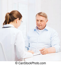 female doctor or nurse with old man prescrbing - healthcare,...