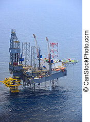 helicopter pick up passenger on the offshore oil rig