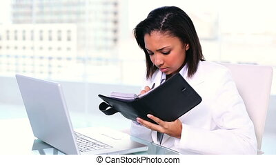 Concentrating businesswoman - Concentrated young...