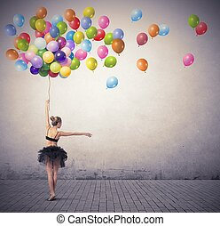 Dancer with balloons - A beautiful girl dancing with...