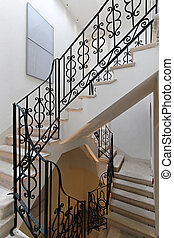 Stairs with iron banister in old house