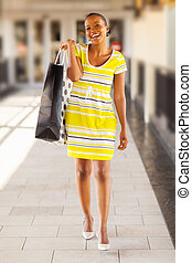 black woman carrying shopping bag - attractive black woman...
